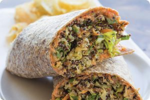 Fresh veggie and quinoa wrap with sun-dried tomato aiolo
