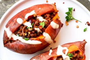 bbq lentil stuffed sweet potatoes with tahini sauce